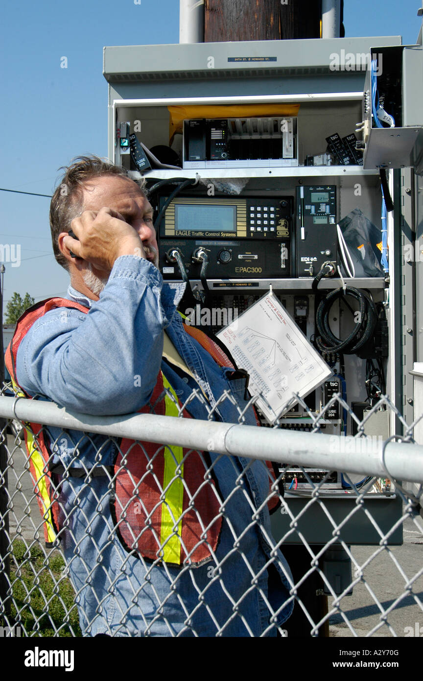 Adult Male Telephone Technician Works On A Communications Problem ...