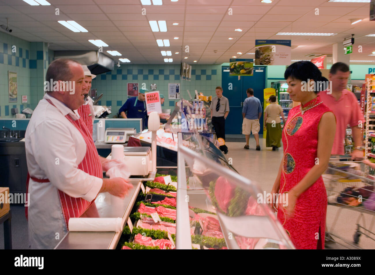 Stunning Chinese Woman Wearing Traditional Dress Shopping In Supermarket With Wedding Traditions