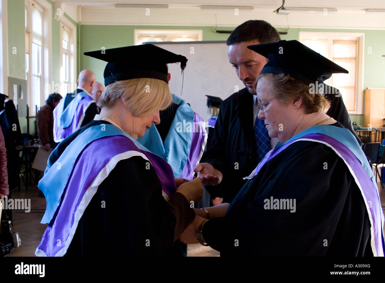 mature students graduating from college in stock photo mature students graduating from college in