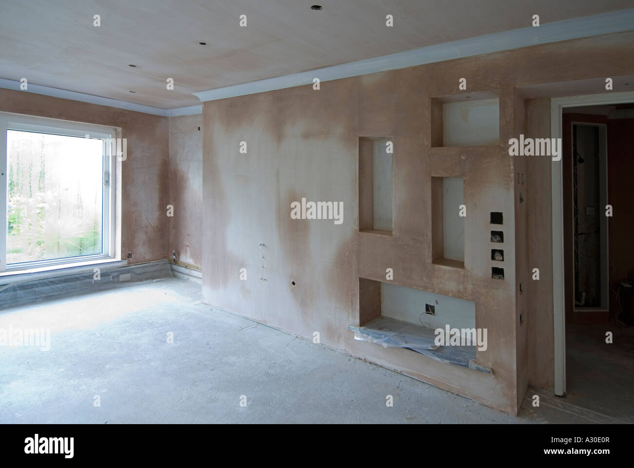 Makeover lounge  new lighting  new recesses  wet pink plaster drying out  before decorating  for decorated view see Alamy A3WTPX Makeover lounge  new lighting  new recesses  wet pink plaster  . Lounge Lighting. Home Design Ideas