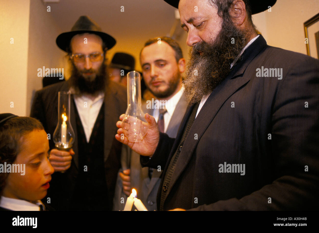 An Orthodox Jewish Rabbi lighting candles with a boy at a Jewish Wedding in Jerusalem Israel  sc 1 st  Alamy & An Orthodox Jewish Rabbi lighting candles with a boy at a Jewish ... azcodes.com