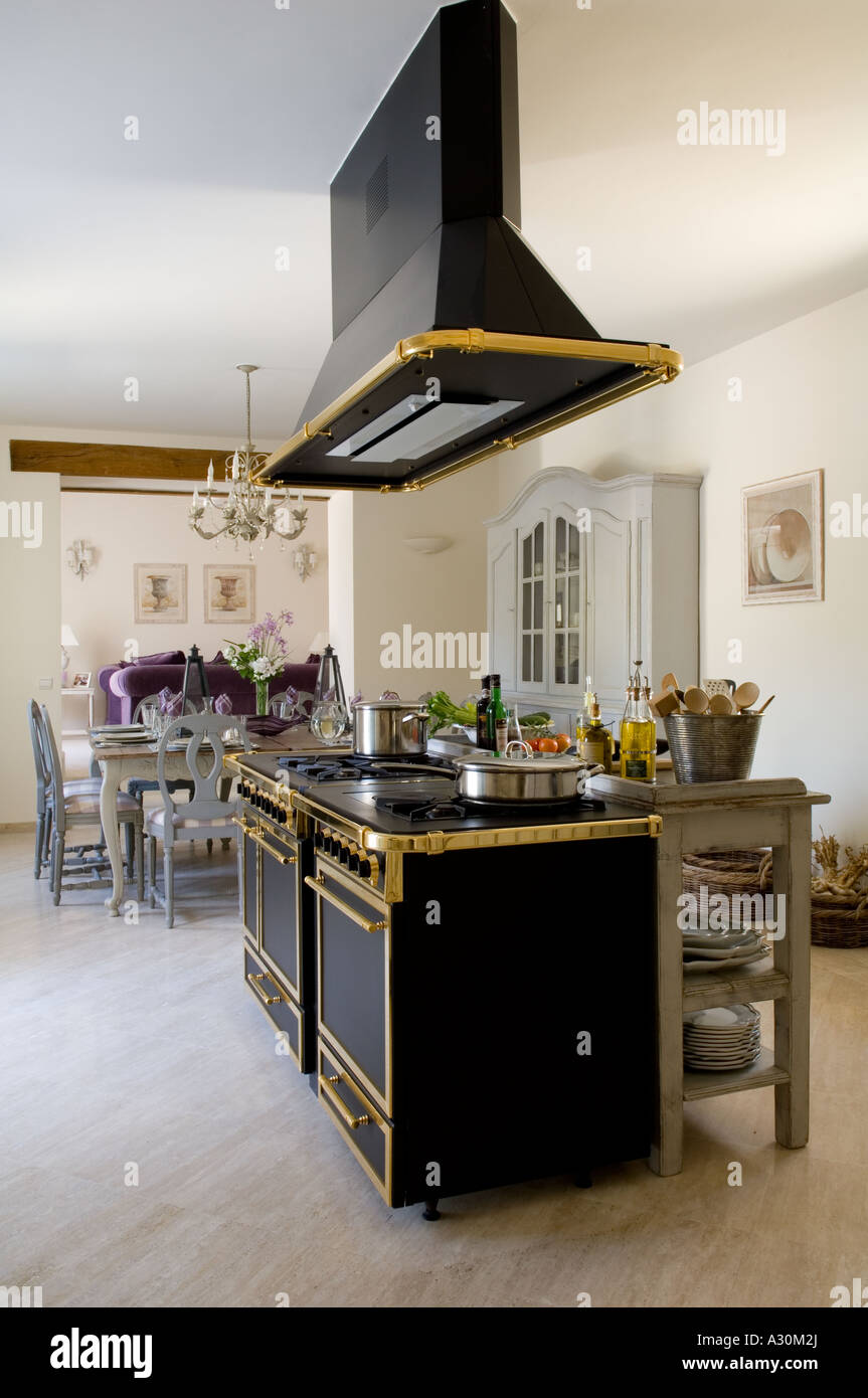 Ornate extractor fan over freestanding gilt plated oven in open ornate extractor fan over freestanding gilt plated oven in open plan kitchen aloadofball Image collections