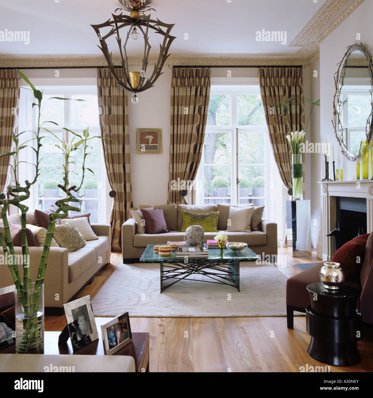 Checked curtains in living room with sofas and light fitting Stock ... for Light Fittings For Living Room  587fsj