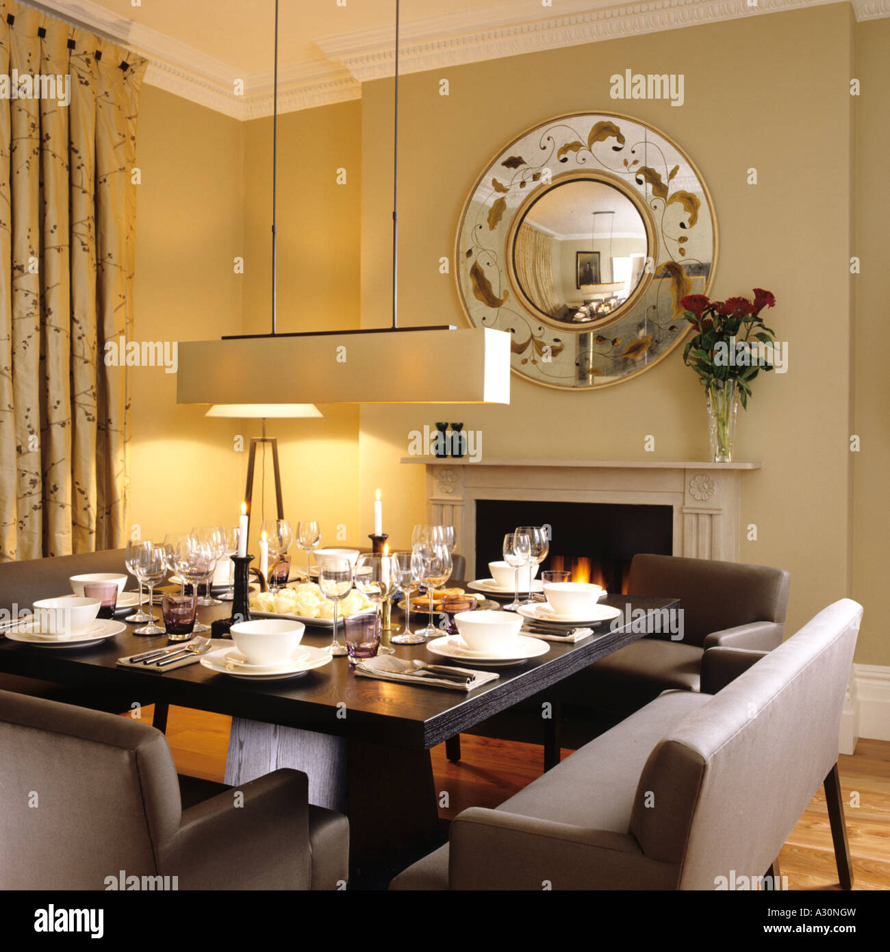 Dining room table with bench seating - Square Dining Room Table With Double Bench Seating And Open Fire Under Circular Mirror