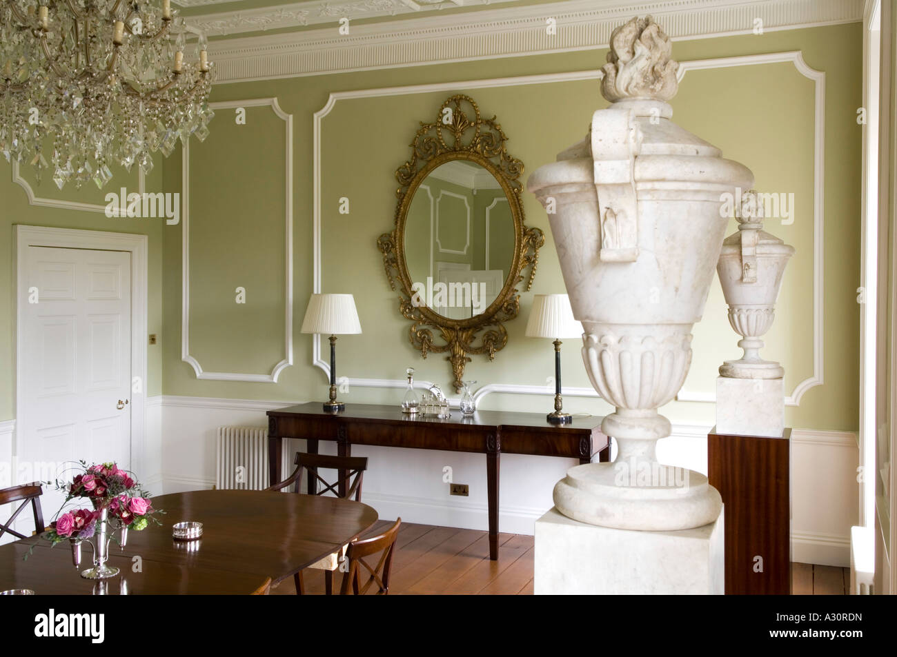 Large ornamental vases - Green Dining Room With Large Ornamental Vases On Plinths