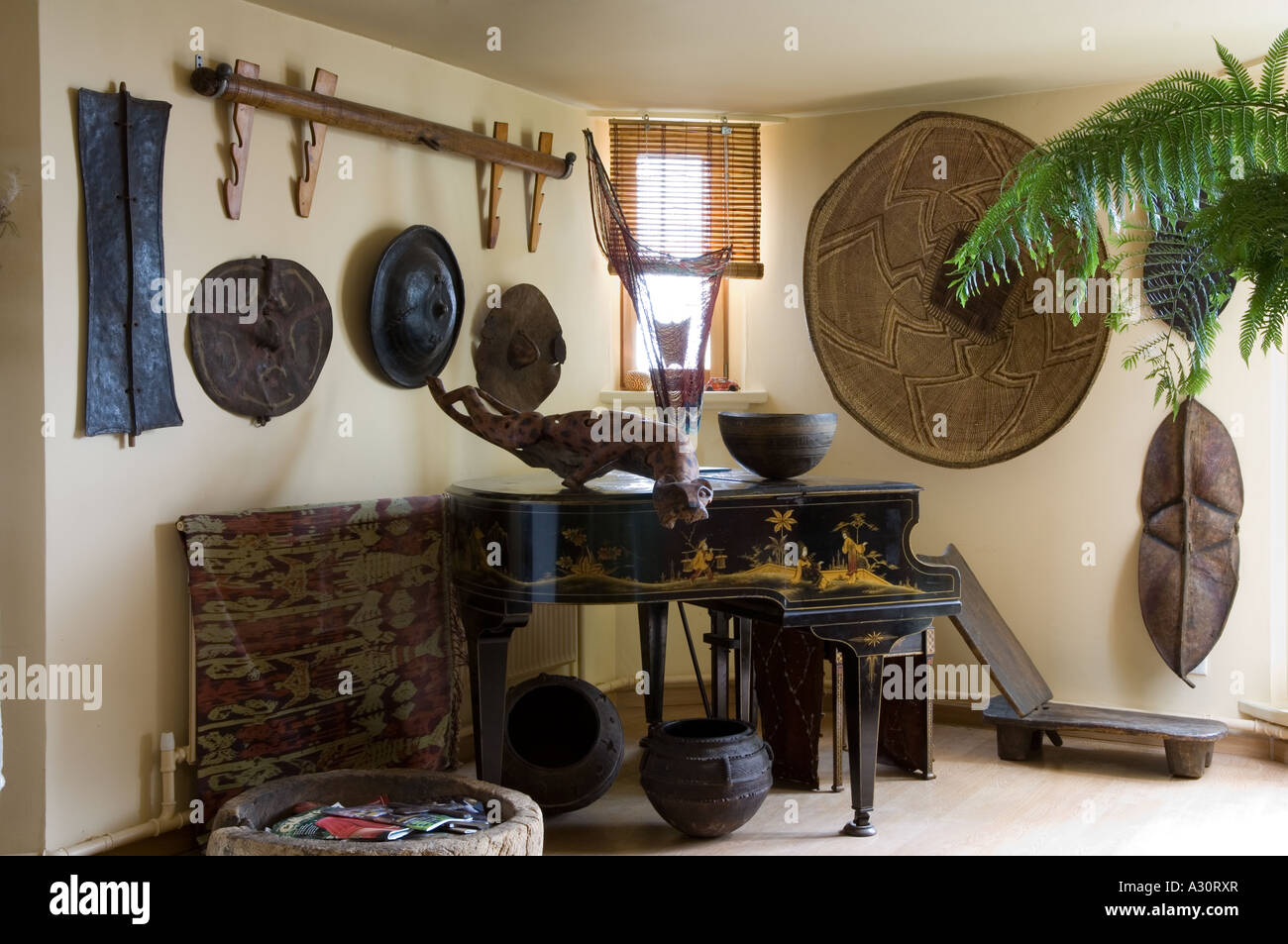 Corner Of A Room With Baby Grand Piano And African Art Objects