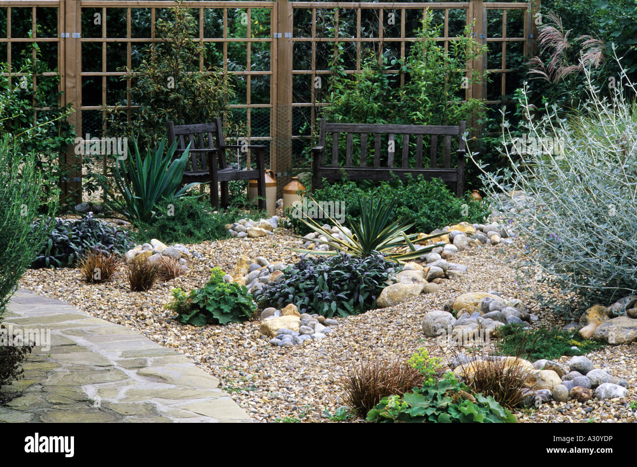 Gravel garden path trellis bench drought tolerant plants for Garden rocks and pebbles