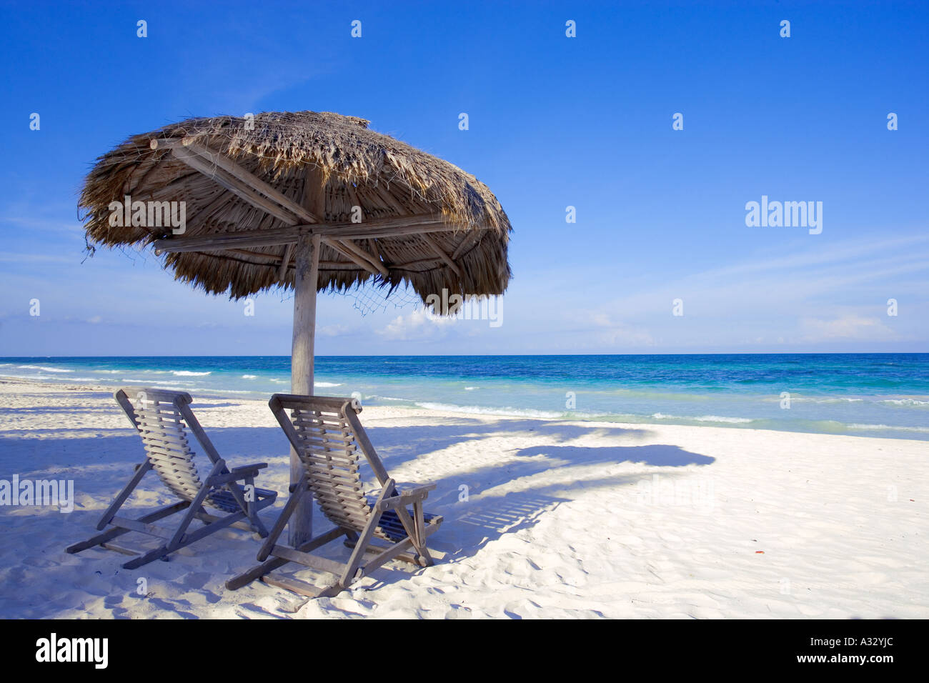 Caribbean Beach Scenes: Caribbean Beach Scene With Two Chairs Under Shade Palapa
