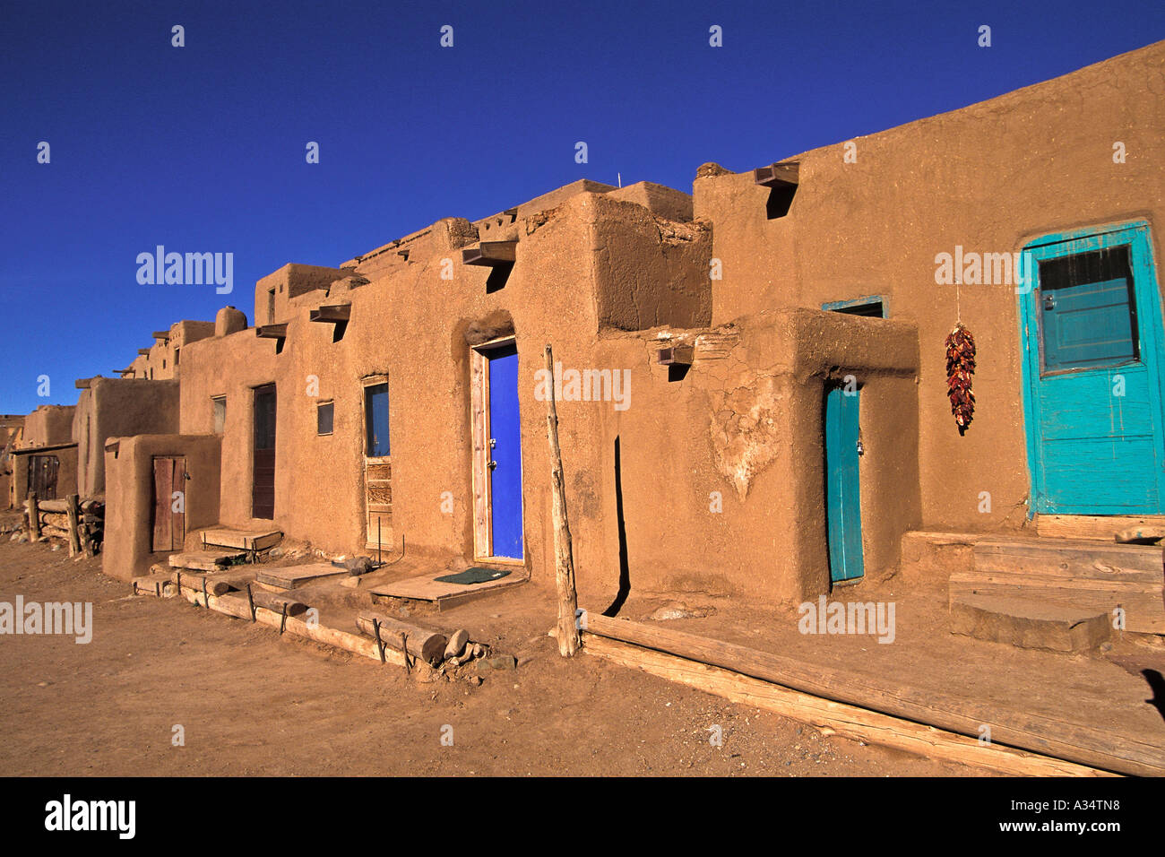 Taos pueblo native american community adobe homes taos new for Pueblo home builders