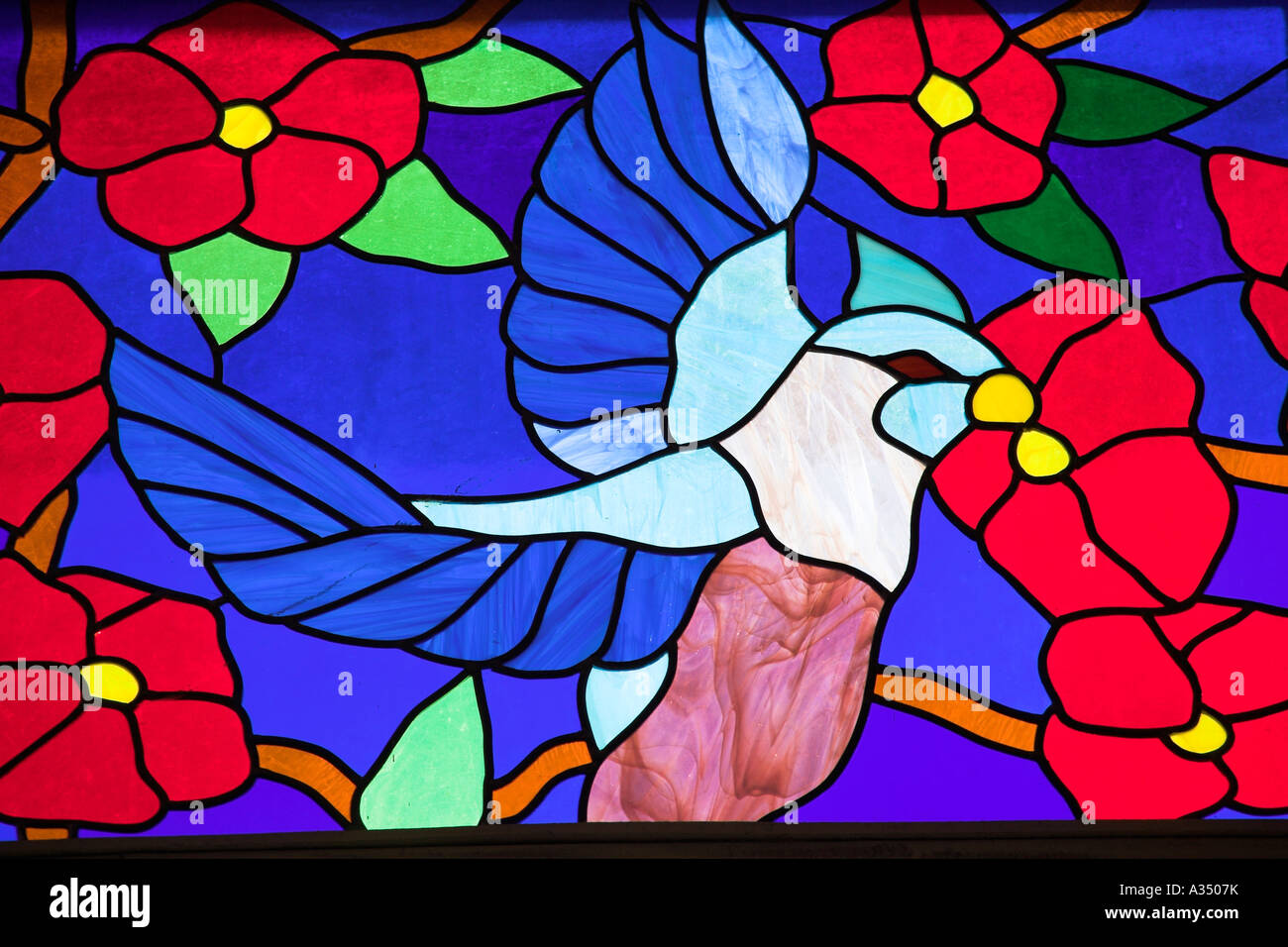 Colourful Stained Glass Window Of A Bird Perched In A Tree