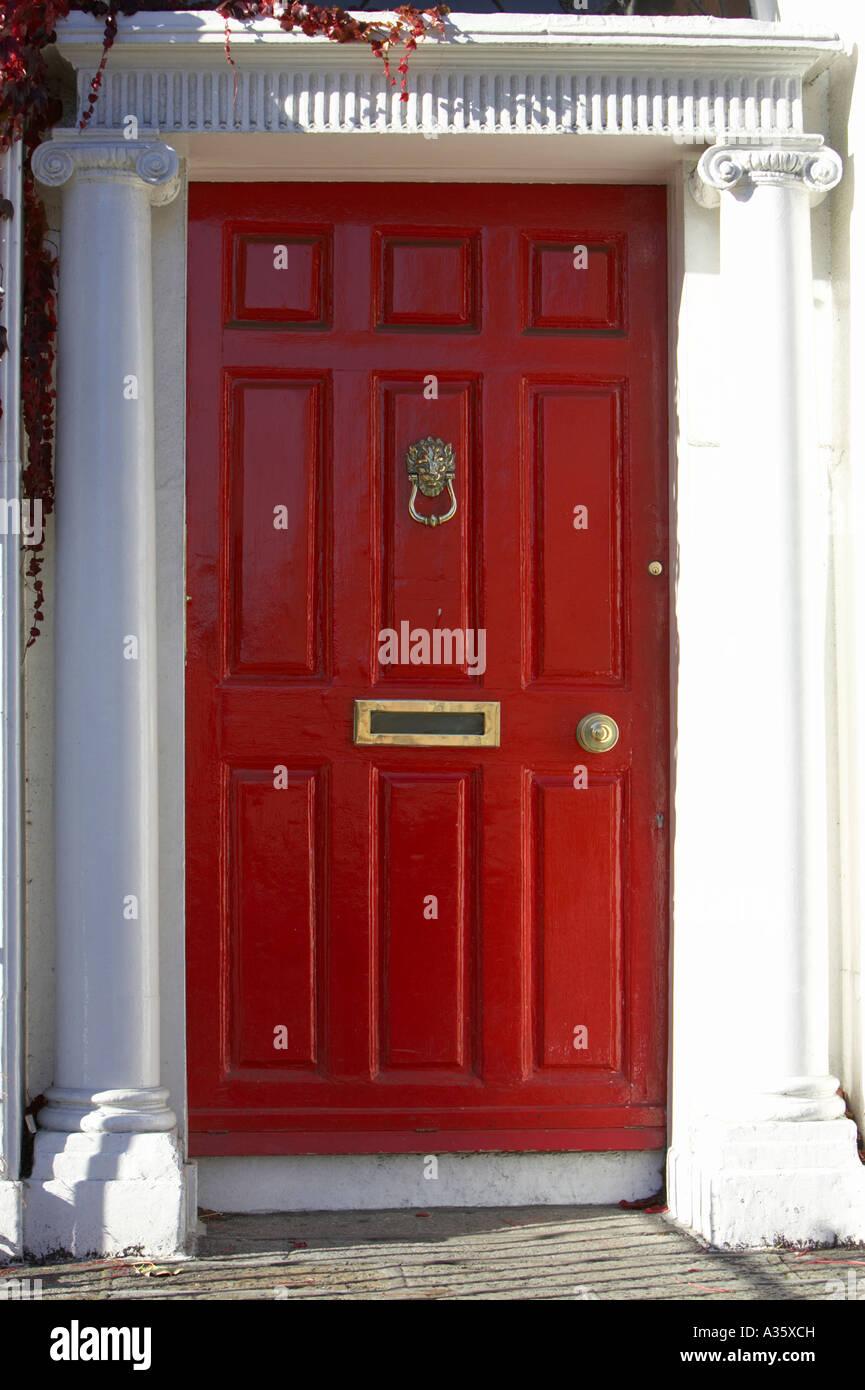red georgian door with brass letterbox door knob and knocker in