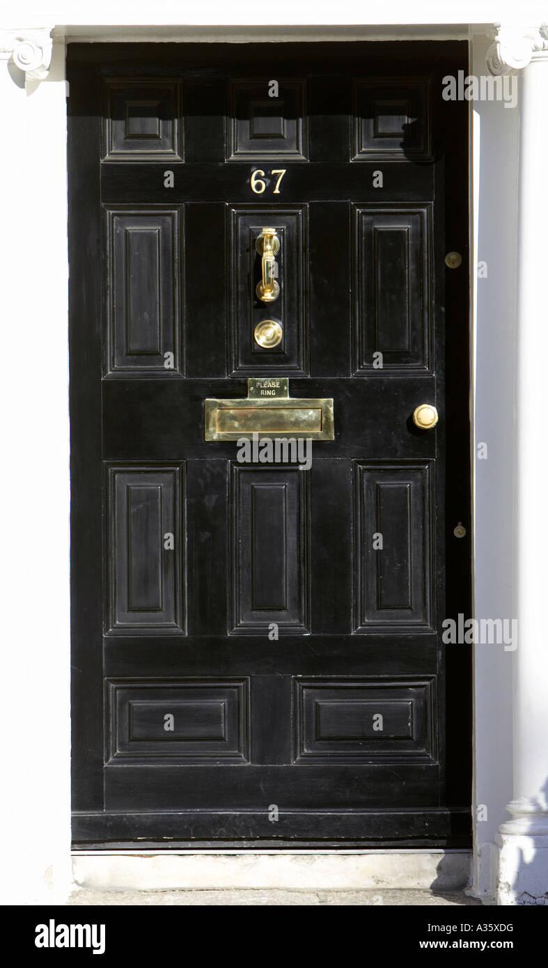 black georgian door with brass letterbox door knob and knocker in