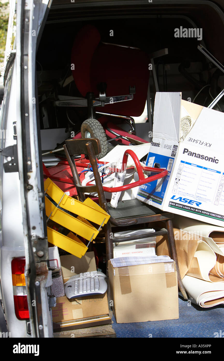 Boxes And Office Equipment Furniture And Rubbish Piled Up In The