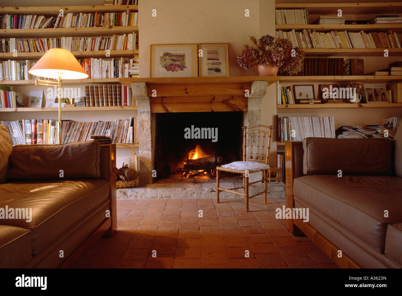 bookshelves on either side of fireplace in country sittingroom