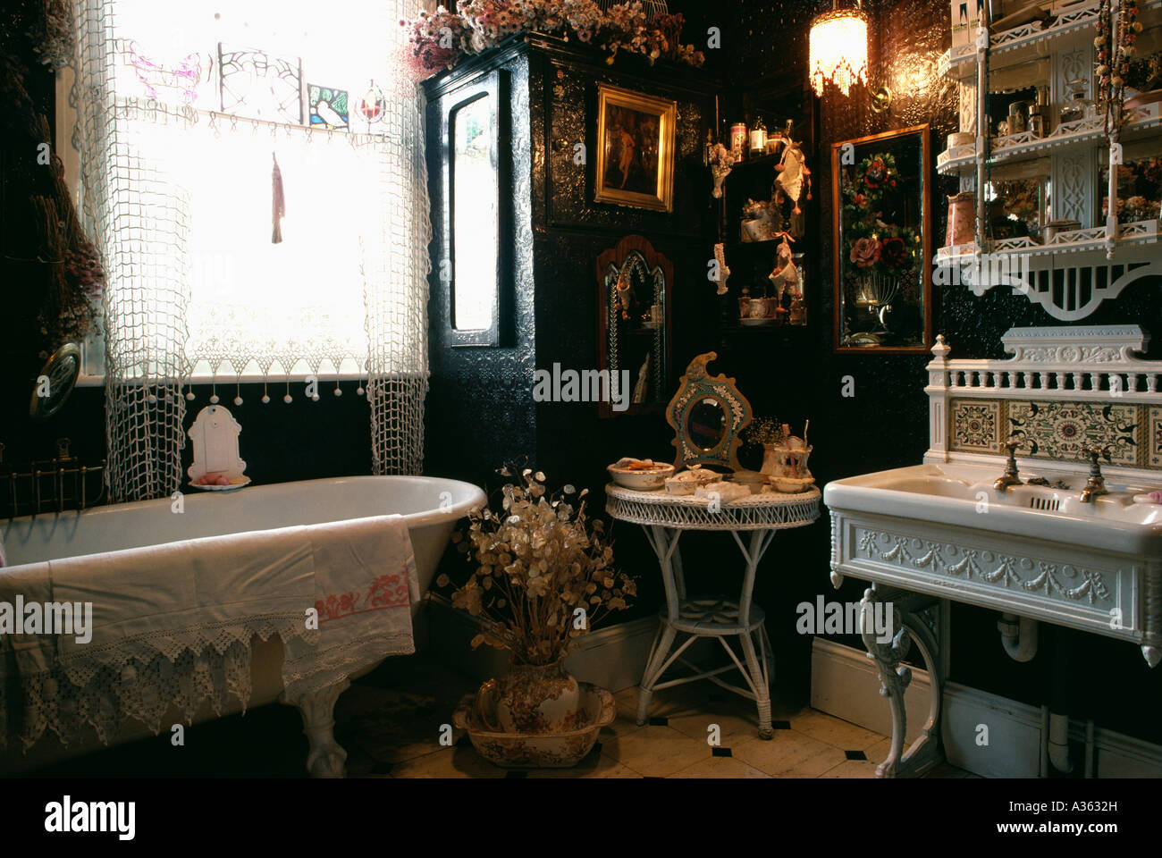Victorian Style Bathroom With Black Anaglypta Wallpaper And White  Freestanding Bath