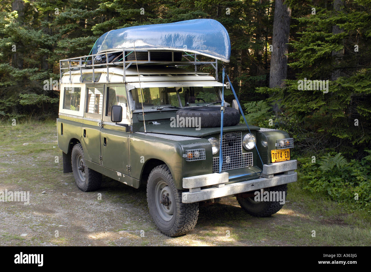 Land Rover Series 2a 109 With Canoe In Woods Stock Photo