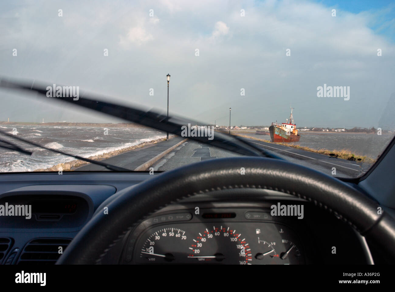 stormy day a rain swept and wind swept road viewed from inside a car stock photo royalty free. Black Bedroom Furniture Sets. Home Design Ideas