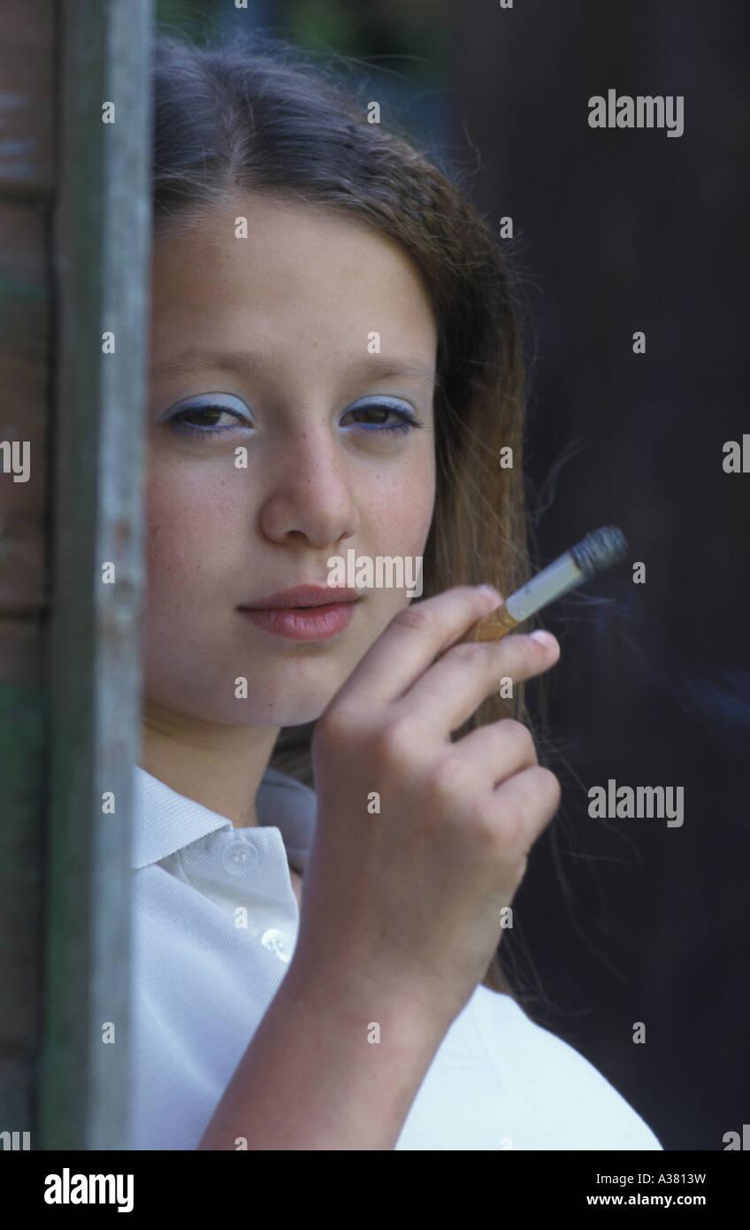 underage smoking school girl smoking - Stock Image