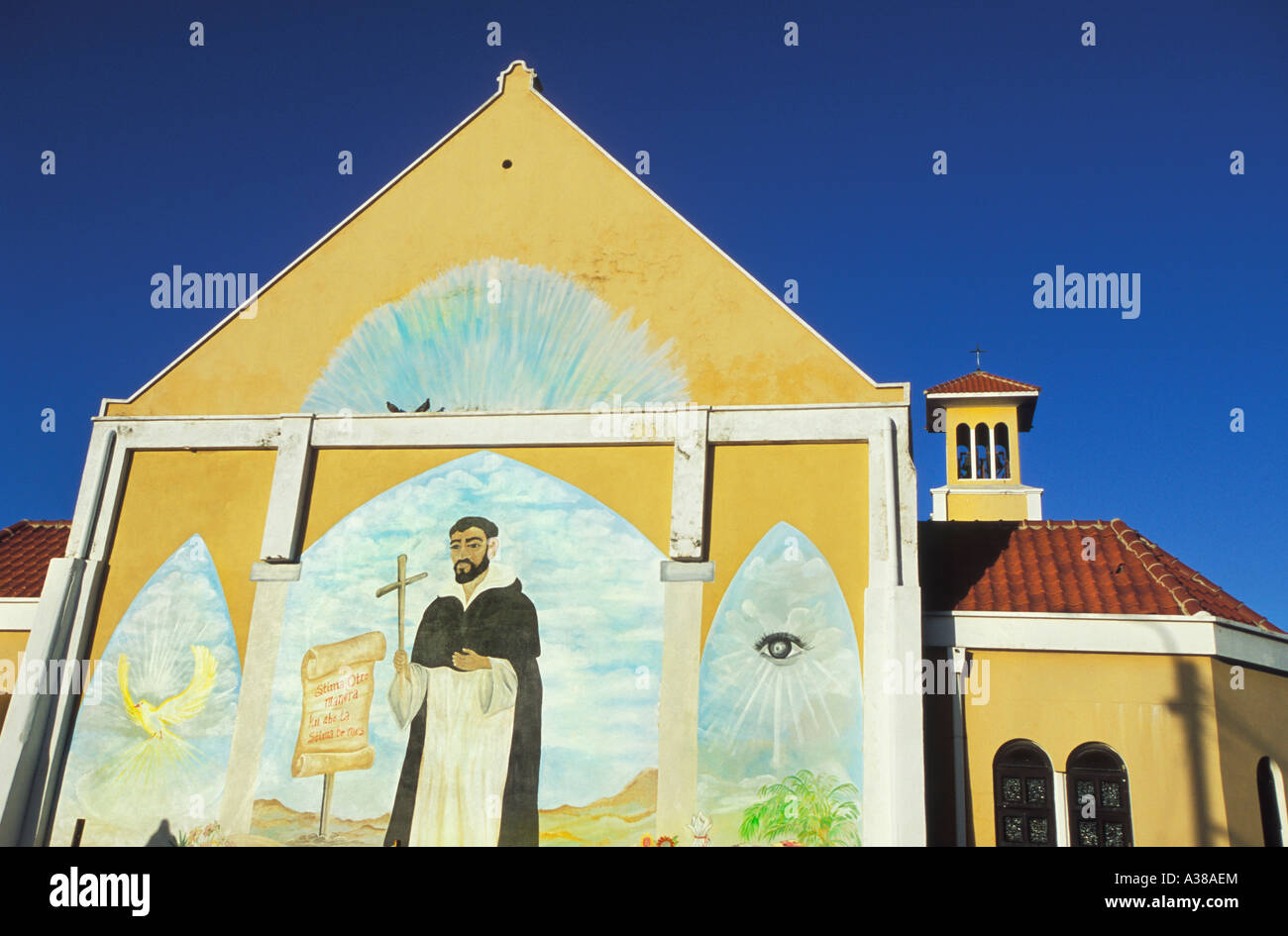 A religious mural adorns the wall of a church in rincon for Church wall mural