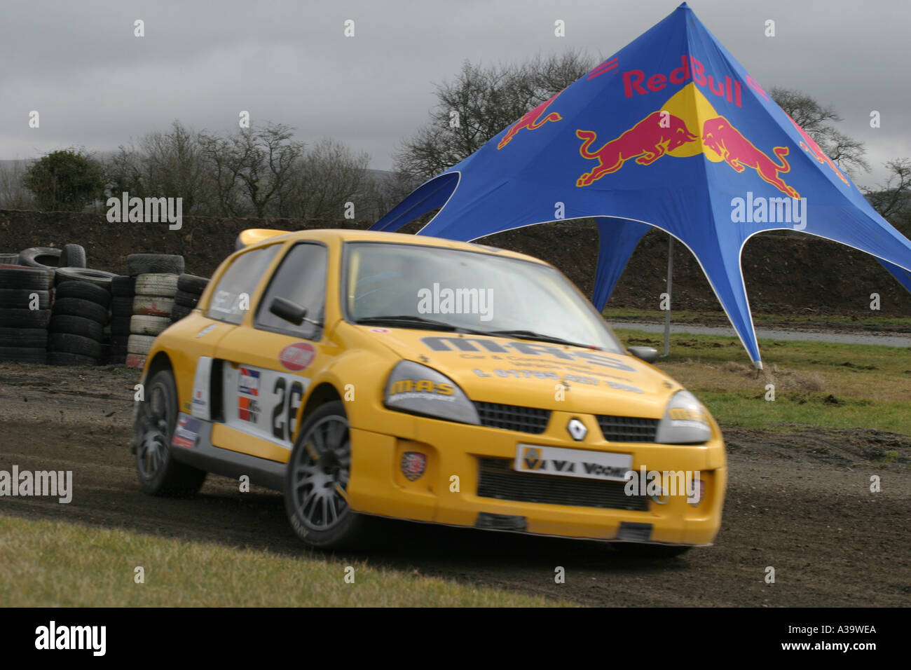 Renault Clio rallycross car slides past the Red Bull tent British Rallycross ch&ionship Nutts Corner motorsport circuit & Renault Clio rallycross car slides past the Red Bull tent British ...