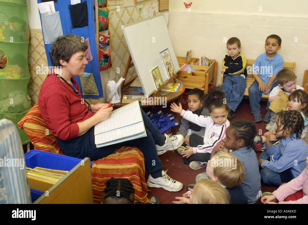 Nursery school teacher taking a role call in class Stock Photo ...