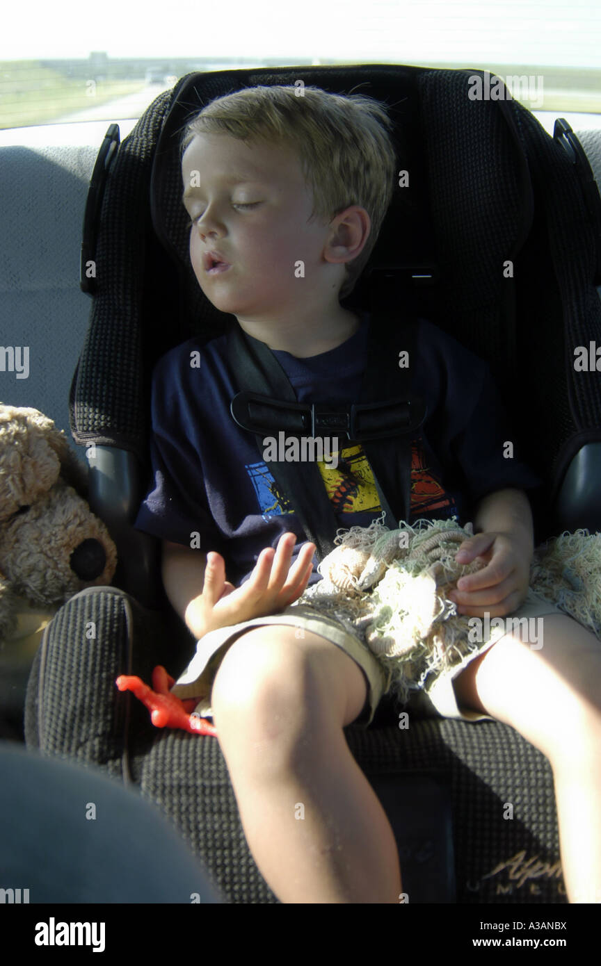 P22 098 4 Year Old Boy Sleeping In Car Seat MR Stock Photo