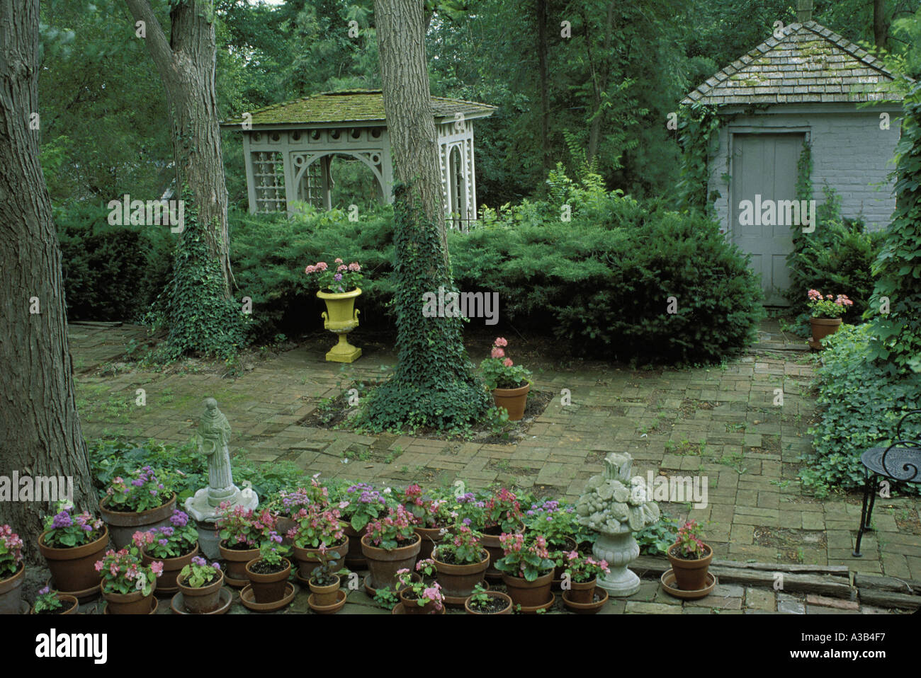 Antique Brick Patio With Gazebo And Shed Decorated With Statuary, Pots Of  Flowers Boston Ivy