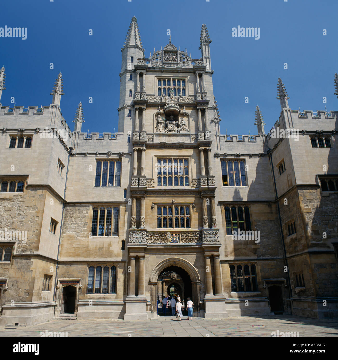 ENGLAND Oxfordshire Oxford University Architecture Old Bodleian Library  Exterior Facade People Walking Through Archway