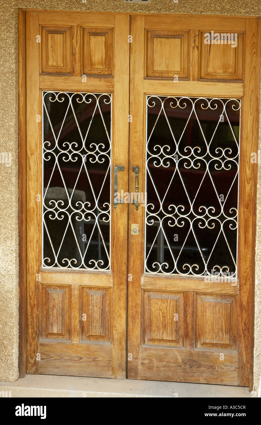 double wooden doors with wrought iron decorative window guards Tenerife Canary Islands Spain & double wooden doors with wrought iron decorative window guards ...