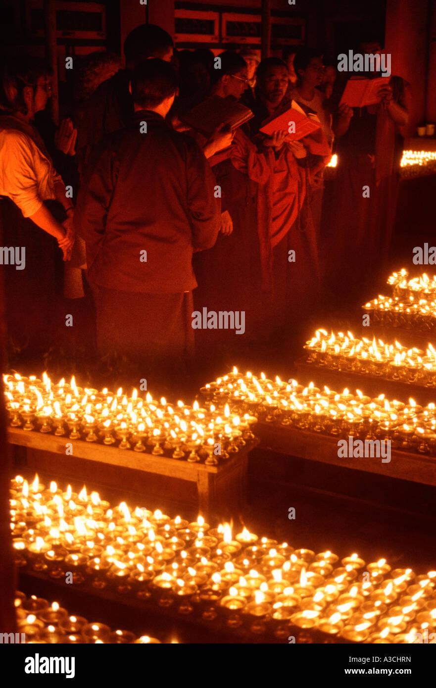 Tibetan Buddhist monks praying in a monastery in Nepal ...