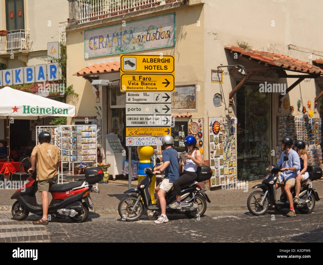 Tourists on Motor Hire Bikes Sorrento Bay of Naples Italy Stock ...