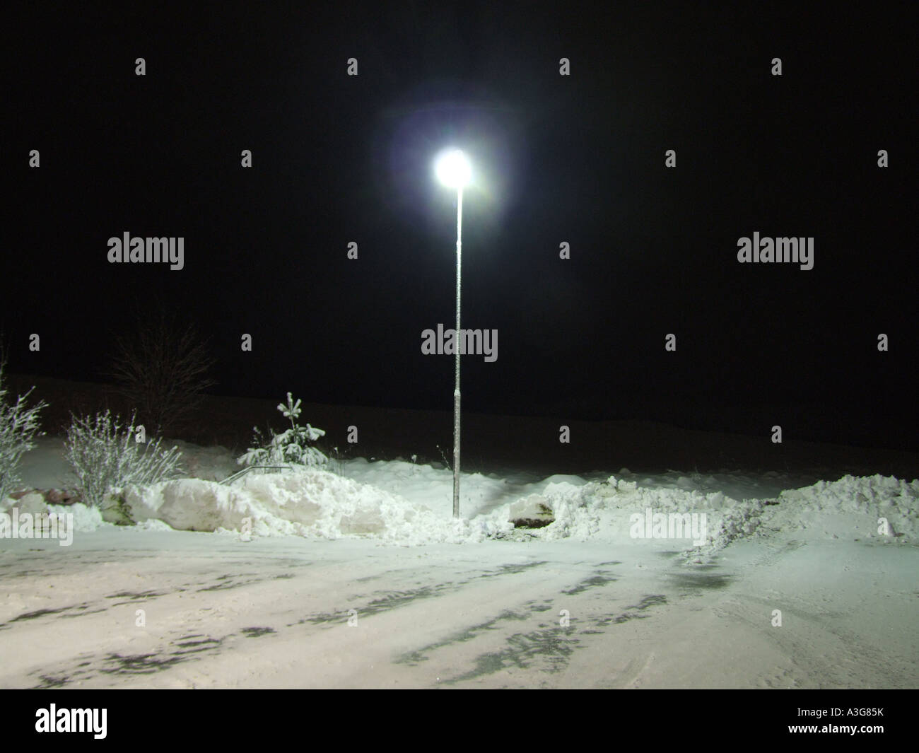lamp post by snow covered road Stock Photo, Royalty Free Image ... for Lamp Post At Night Snow  131fsj