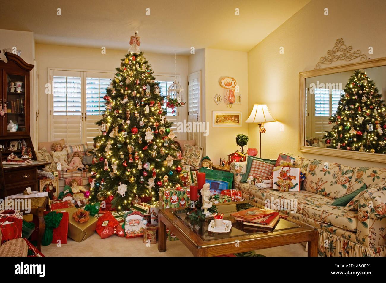 Christmas tree decorations and gifts in living room of upscale
