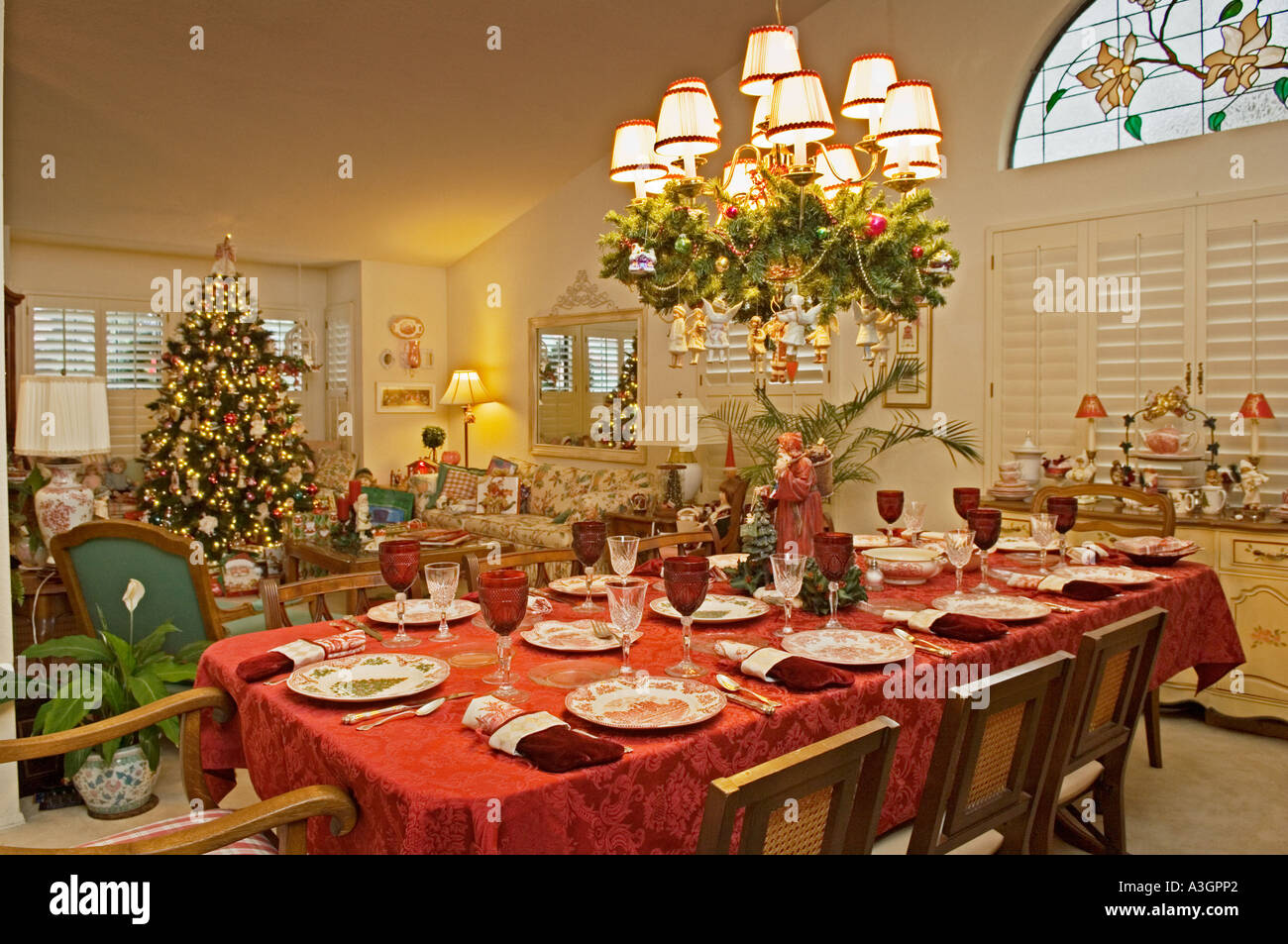 Dining room table set for Christmas dinner in living room of upscale house  in southern California