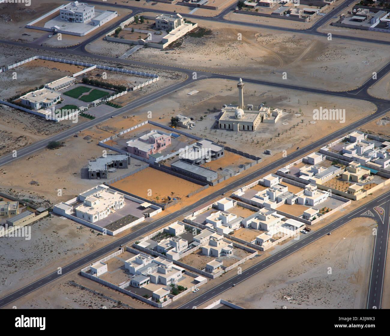 Fish aquarium in umm al quwain - Housing And Mosque Umm Al Quwain Dubai Uae Aerial View Stock Image