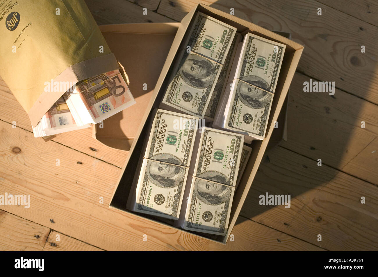 Stacks Of Money In Shoebox