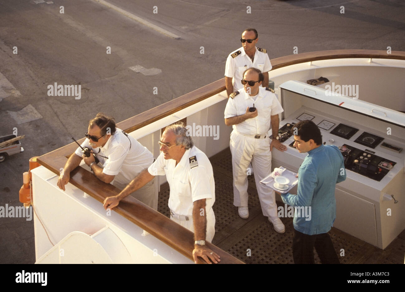 Ships Captain Officers With Local Pilot On Cruise Ship Wing - Steward cruise ship
