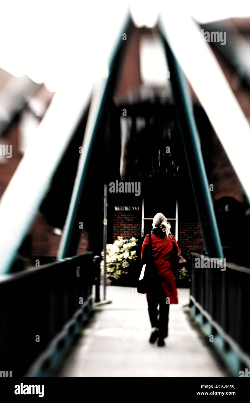 Woman Walking Over Bridge In Red Coat Stock Photo Royalty Free