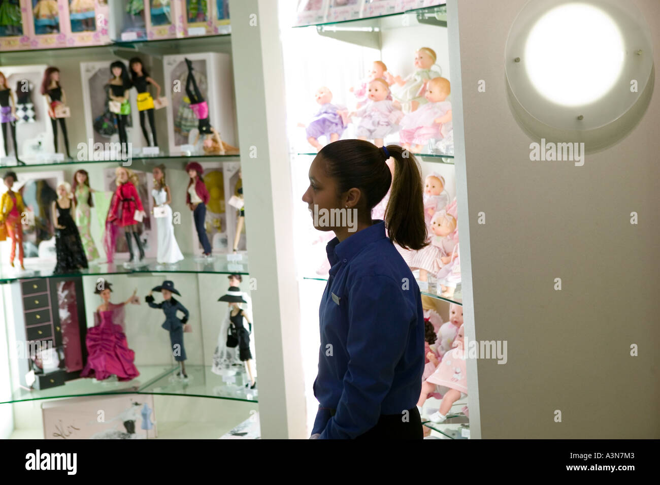 A salesperson stands by a doll display at the fao schwarz toy a salesperson stands by a doll display at the fao schwarz toy store on 5th avenue in new york city ny usa november 2004 sciox Image collections