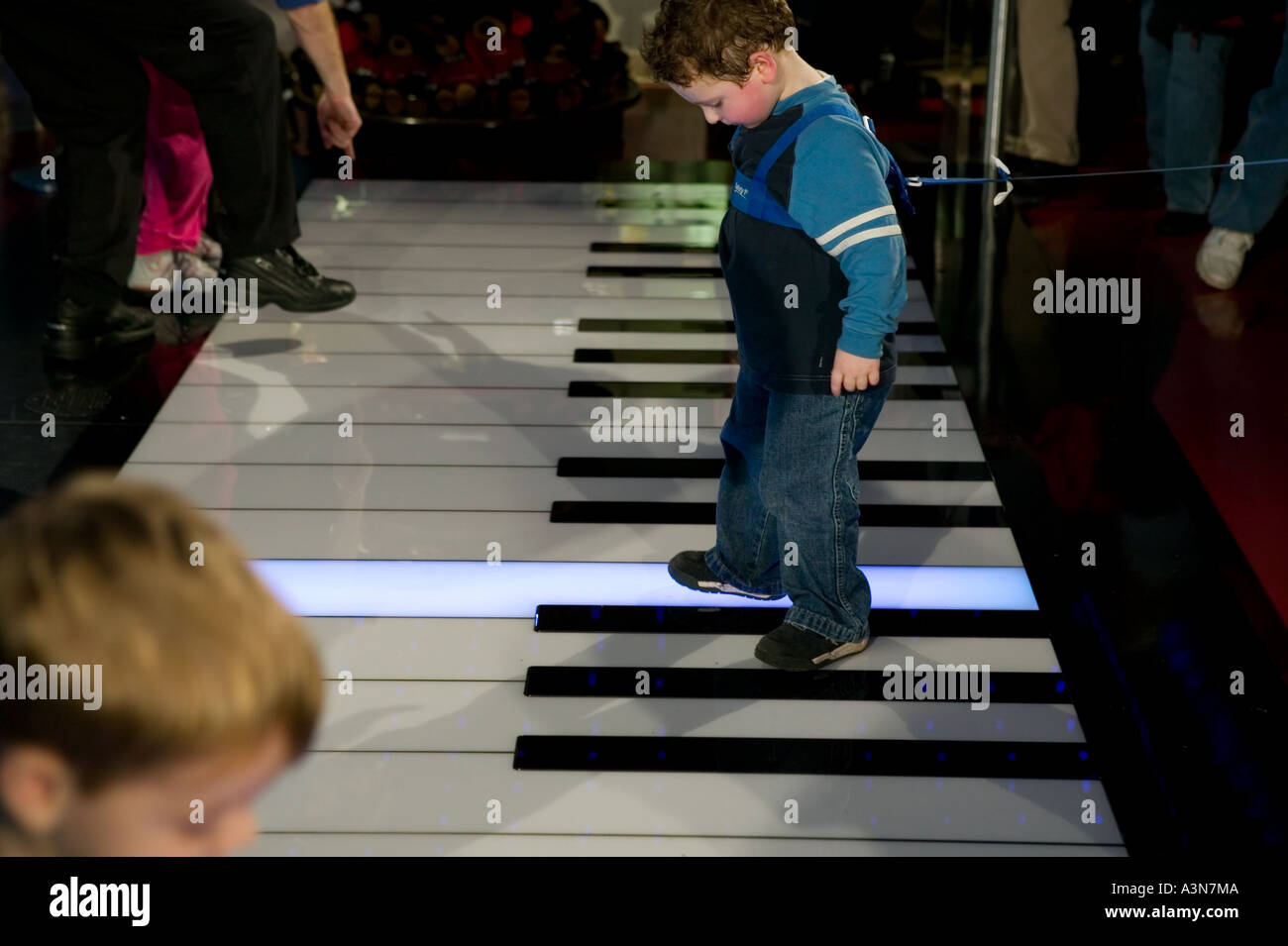 Children play on the giant piano keyboard at the fao schwarz toy children play on the giant piano keyboard at the fao schwarz toy store on 5th avenue in new york city ny usa november 2004 sciox Image collections