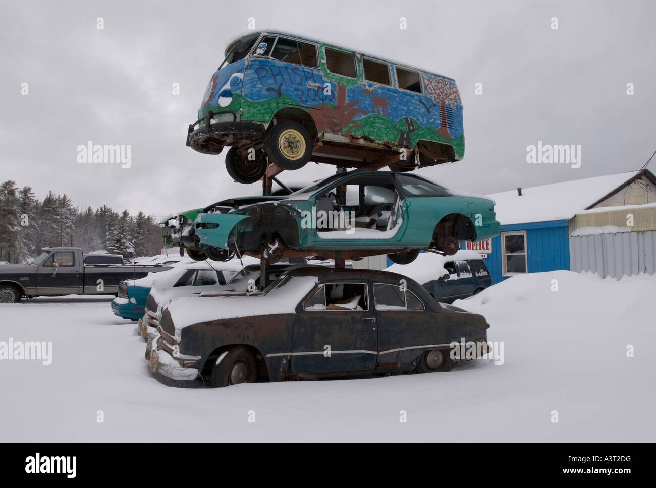 A Volkswagen bus tops a stack of cars at a junkyard near Marquette ...