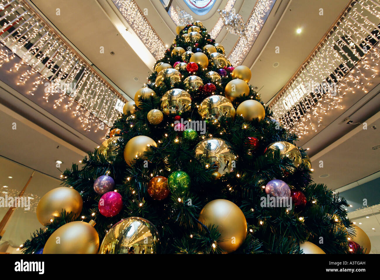 Christmas tree decorated with big balls at the hall of a Large decorated christmas trees
