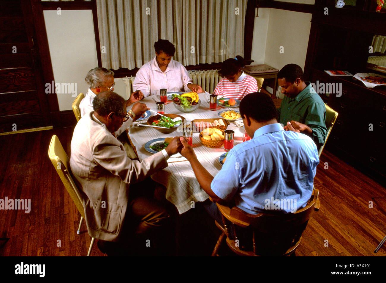 Black Family Of Three Generations Saying Grace At Dinner Table St Paul Minnesota USA