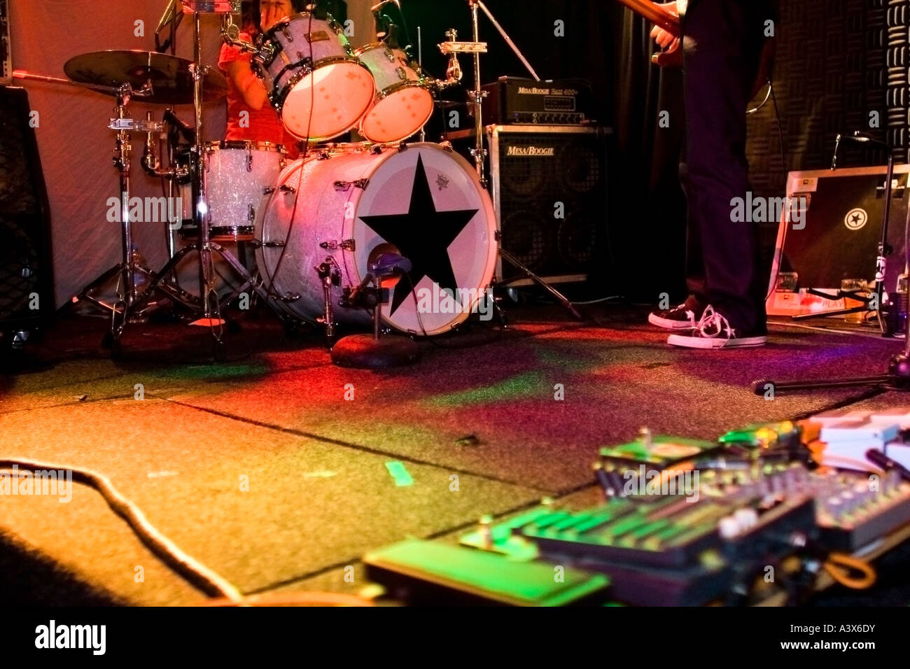 Rock And Roll Drum Kit On Stage With Guitar Effects Pedals In The Foreground