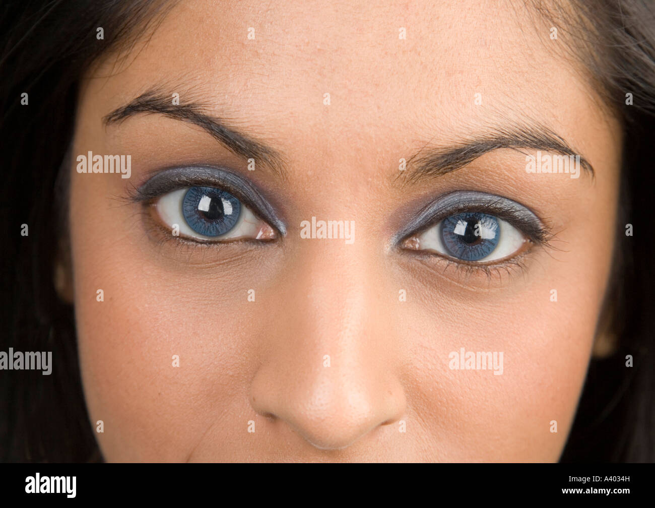 young asian woman close up with blue eyes stock photo