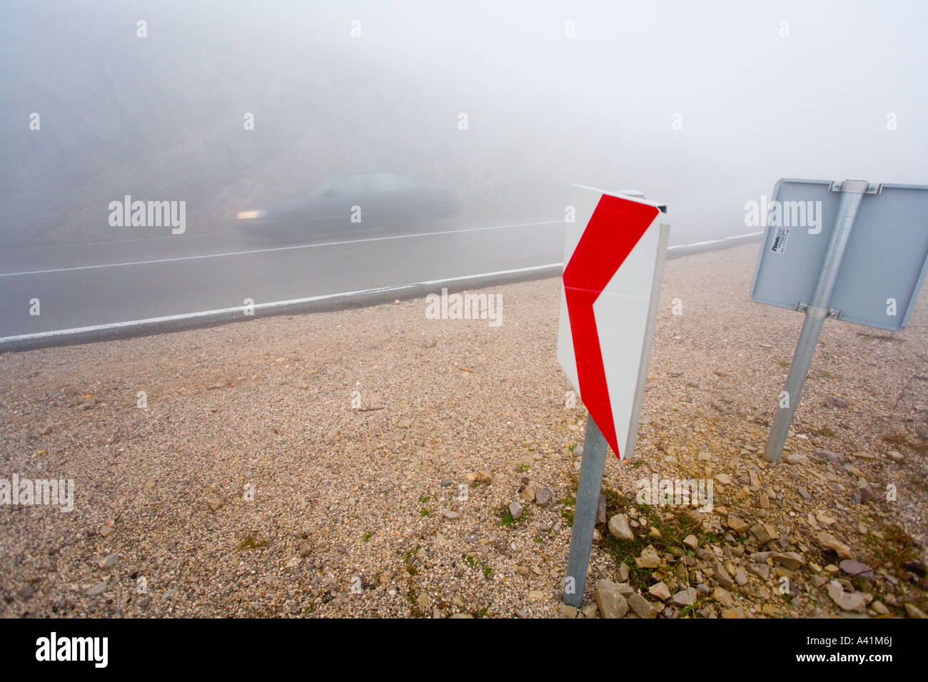Fog On Road And Blurry Car Passing By Plus Sign Meaning Left - Car sign meanings