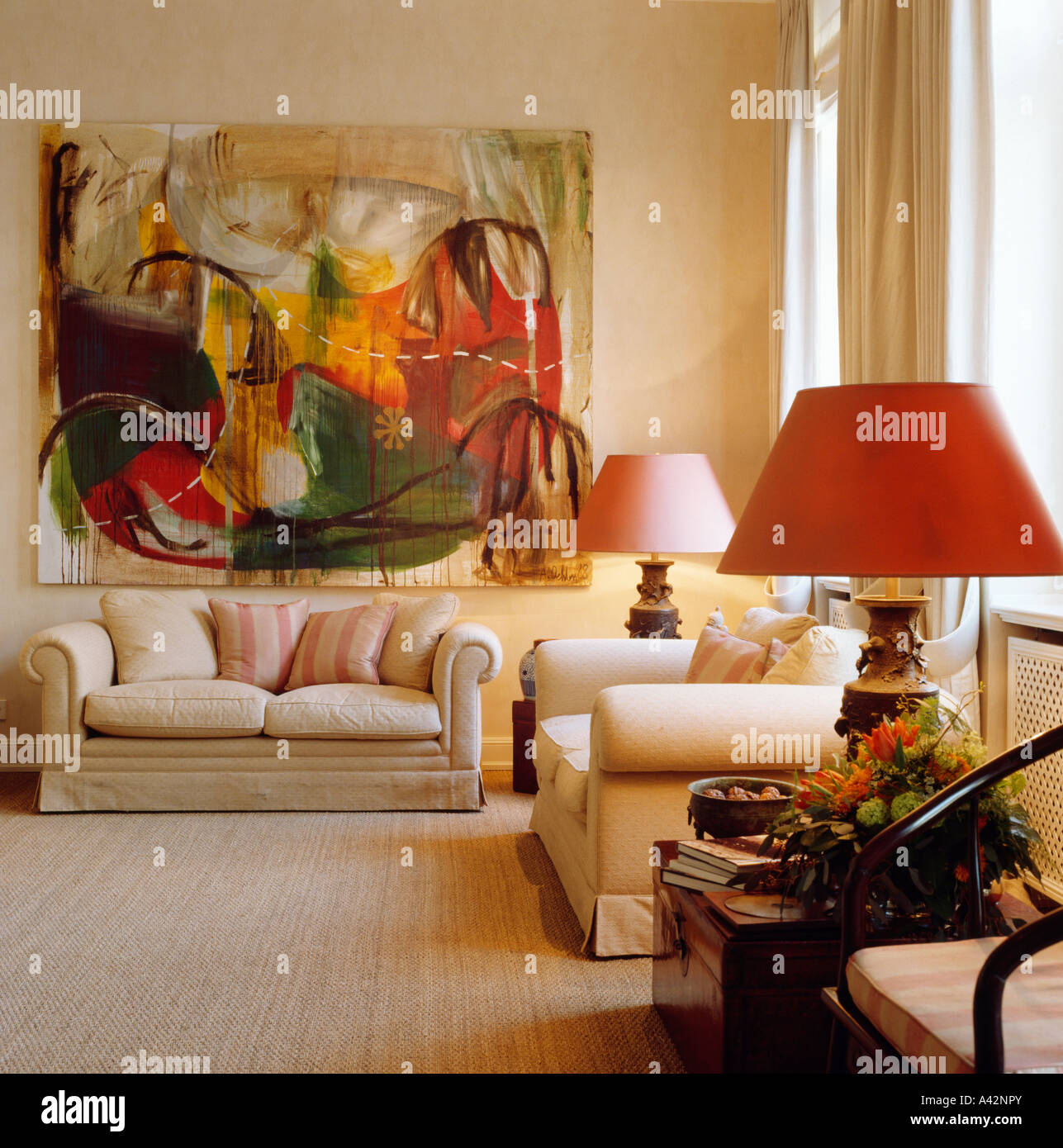 Large Abstract Painting Above Cream Sofa In Upmarket