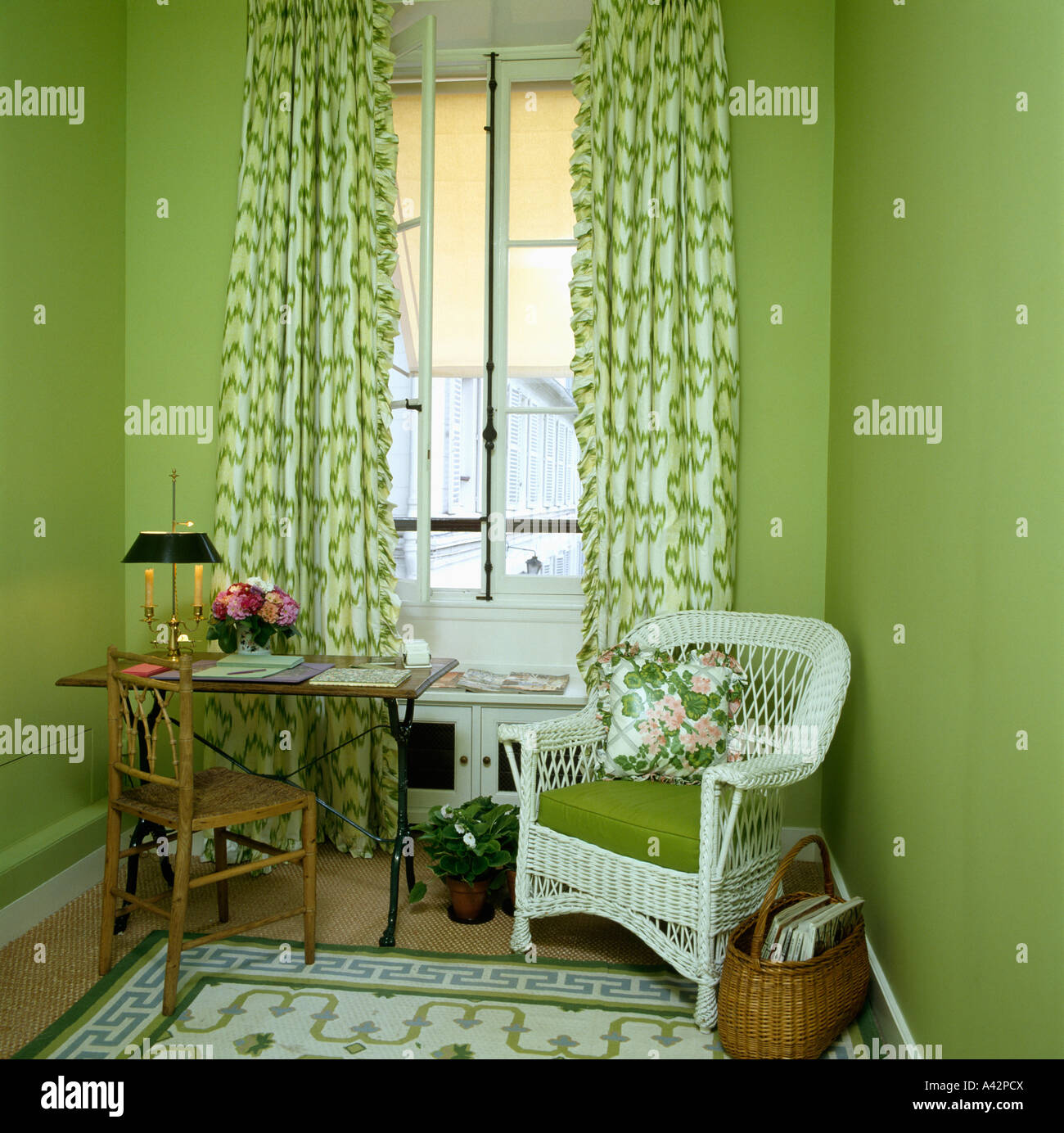 Small Green Workroom With And White Patterned Drapes Wicker Chair Cushion