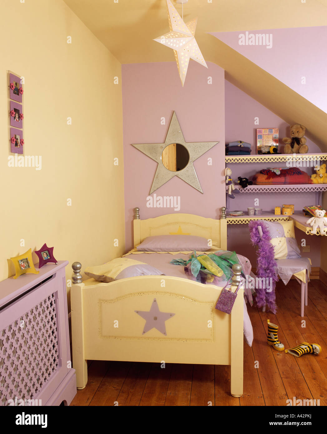 child s bedroom with pastel yellow and purple walls and pale