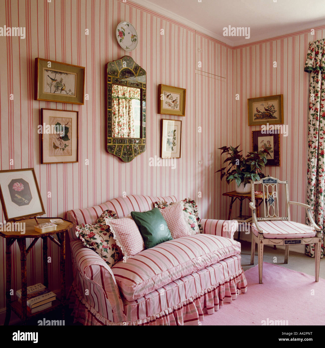 Pink striped sofa in country living room with pink striped for Pink living room wallpaper